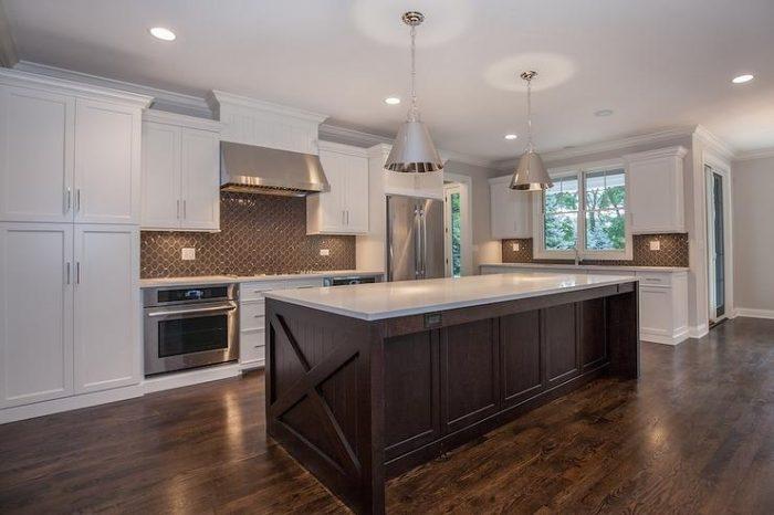 brown-arbesque-tile-backsplash-cooktop-between-ovens